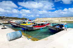 Sea Juggernauts (arwin.palac) Tags: chasinglight landscapephotography landscape seascape seascapes ports boats harbor batanes batanesislove canon canonph benro benroph itsmorefuninthephilippines
