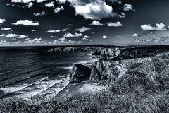 Monochrome (Explored) (Esox2402) Tags: bw monochrome coast sea rocks cliff grass clouds sky canon waves