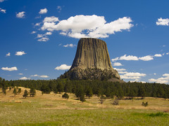 The Tower in the Sky (RobertCross1 (off and on)) Tags: 1250mmf3563mzuiko devilstowernationalmonument em5 mountainwest omd olympus wy wyoming bluesky clouds forest grass grassland landscape mountain nature plains trees volcanic