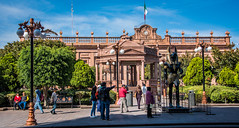 2016 - Mexico - San Luis Potosi - Plaza de Armas (Ted's photos - Returns late December) Tags: 2016 cropped mexico nikon nikond750 nikonfx sanluispotosi tedmcgrath tedsphotos tedsphotosmexico vignetting tutankhamun tutankhamunsanluispotosi tut tutsanluispotosi plazadearmas plazadearmassanluispotosi sanluispotosiplazadearmas palaciodegobierno palaciodegobiernosanluispotosi sanluispotosipalaciodegobierno thetombthegoldandthecurse sanluispotosiphotos streetscene people peopleandpaths streetlight streetlamp benches seating seated shadows gazebo bandstand flag mexicoflag backpack