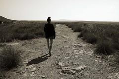 Good bye! (Reto #Camino) (David Cano G.) Tags: bw espaa woman girl canon landscape persona mujer spain chica desert camino paisaje bn gata desierto almera senda cuerpo 2013
