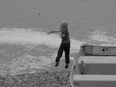 Throwing With All His Might! (Fire*Sprite*75) Tags: boy sea blackandwhite beach monochrome stone photography child son devon throw ilobsterit