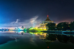 Kuching At Night - Looking At D.U.N (framptoP - E.V.I.L. Photographer) Tags: city longexposure blue cloud reflection building night river asia flickr slow nightscape nightshot image availablelight smoke sony places images tokina sarawak malaysia borneo slowshutter getty alpha kuching longshutter slt gettyimages a77 kuchingwaterfront sonyalpha flickrawards flickraward sarawakborneo iamflickr tokina1116f28 tokina1116 alphagalleria iamlfickr framptop gettyimagesartistpicks blinkagain slt77 a77tokina