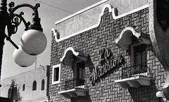 Nuevo Laredo, Mexico (Tejas Cowboy) Tags: city trip blackandwhite bw signs building architecture mexico tourist billboard 1993 business seeing sight laredo 1990s nuevo 90s