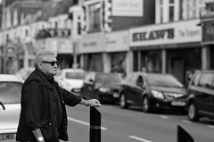 I'm Still Waiting (Just Ard) Tags: street city uk urban blackandwhite bw man sunglasses wales photography nikon candid cardiff 85mm leaning wellfieldroad d7000 justard