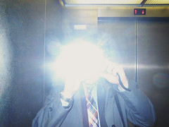 anonymous suit 2013 (patrickhruby) Tags: ohio selfportrait self cleveland flash elevator tie suit faceless savings plaid ricoh selfie ohiosavingsplaza