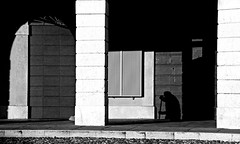 the ghost sweeper (rovato - brescia, italy) (bloodybee) Tags: street door shadow people bw italy man window square europe arch candid porch column brescia sweep broom piazzacavour rovato 365project