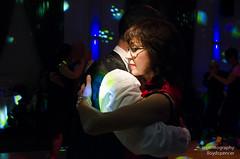 Dancing into the light (Briggate.com) Tags: red orange dance dancers dancing tango masquerade embrace argentinetango tangoball masqueradelns8827