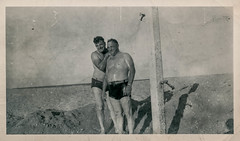 Two men showering on the beach (simpleinsomnia) Tags: ocean old gay white black beach monochrome vintage found shower blackwhite sand shadows florida antique snapshot photograph topless vernacular shorts interest foundphotograph gayinterest