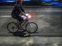 man on a bike at night (Robert Couse-Baker) Tags: street city urban bike bicycle night gritty hss sliderssunday ethanway