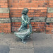 A bronze statue of a girl with a goose outside St. George's Market, Belfast