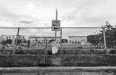 2016-10-27-0019 (alexdotbarber) Tags: 18 2meter 35mm houstonfourthward kodaktmax100 voigtlanderbessal voigtlandersuperwideheliar15mmf45 blackandwhite cemetery f45 onewaysign slowdown underexposed