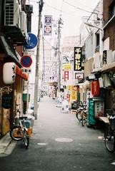 (porkchopsandy) Tags: osaka japan april 2016 film analogue nikonfm2 35mm street signages