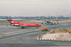 al1532 (George Hamlin) Tags: new york city jamaica queens jfk kennedy international airport airliners airlines aircraft jet boeing 727 douglas dc8 lockheed l1011 n306bn braniff eastern airlift runway taxiway skyline world trade center flying colors construction photo decor george hamlin photography bay