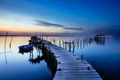 Blue lagoon (J C Mills Photography) Tags: carrasqueira portugal sesimbra alcazer do sal pontoon lagoon tidal boat fishing poles sunset landscape