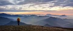 Into the wild (Saramanzinali) Tags: alba sunset sole sun clouds cloudy nuvole colori colours mountains montagne camminare linzone bergamo valle imagna foschia fog person persona escursionista orobie