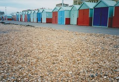 Hove Seafront (brightondj - getting the most from a cheap compact) Tags: cycletouring cycle bikeride bike bicycle hove brightonandhove beachhuts pebbles beach olympusxa scan scanned 35mm 1990s