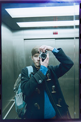 (reinhard montgomery) Tags: portrait selfportrait analog self 35mm canon mirror fuji ae1 superia elevator 200