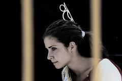 Curiosity (Hernan Piera) Tags: mujer adolescente feria ella andalucia mirada malaga curiosa marbella joven flamenca intriga barrotes peineta labiosapretados