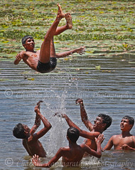 Youth Play in the water (Chamila Karunarathne) Tags: lake boys water weather youth photojournalism temperature dailylife colombo srilankan heatwave hotday cooloff hotweather playinthewater southwestmonsoon temperaturehitting