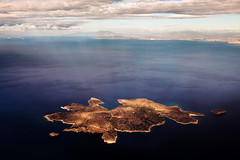 simpsons clouds (amira_a) Tags: sea clouds island fuji simpsons athens aerial explore greece getty fujifilm sunrays gettyimages 425 x100 smallisland fleves simpsonsclouds x100s 30112013