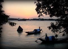 Peaceful (mala singh) Tags: sunset india water river boats kolkata hooghly