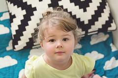 Sweetheart (Bridie Murray) Tags: portrait ikea modern clouds canon eyes focus toddler dof daughter curls naturallight blond 7d blonde bun 2470l bedding 3rdyear naturallightportraiture canon7d