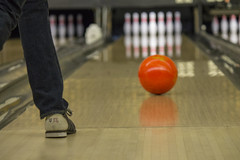 Day 18 - Kingpin (brandondesign) Tags: wood orange blur sports sport ball fun person foot shoe leg perspective pins lane bowling 365 bowlingball project365 365project