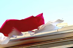 Sunday  Greek Illusions (mare_maris (very slow)) Tags: blue roof light red summer sky panorama sun white house color reflection ikea colors beautiful digital windyday vent photography fly flying spring wire truth colorful warm heaven locals emotion time candid balcony space dream fuchsia levitation fast dry explore greece wash laundry photograph attic imagine hanging imagination ripples clotheslines pegs waved inflate fabrics ordinary lightblue madura pleasent linens inflating pillowcases viewpoints zarahome e dailychores hmhome windyhope truthillusion aythentic greeklaundrybalcony fastripples flyingwithoutphotoshop wavinginthesky greeklaundryoutside openlightblue hihigherhighestoutstretchedin