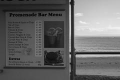 Seaside menu Barry Island (Dai Lygad) Tags: stockphoto stockimage menu sea seaside food chips sundayafternoon barryisland noiretblanc dailygad jeremysegrott segrott jeremy caerdydd caerdyddwales photo picture image photograph