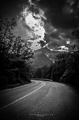 shadow road (papkostantin) Tags: road vignette mountain forest clouds dark bnw bw blackandwhite shadows trees view greece mountains autumn sky shadowclouds nature naturegreece skyporn landscape naturelover