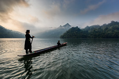 Morning on the lake (Asian Hideaways Photography) Tags: asia asian ambiance ethnic exterior people travel travelphotography tay sky sunrise southeastasia landscape light woman women water candid vietnam boat naturallight pirogue lake babe