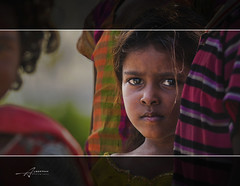 Through the eye (Albert Photo) Tags: girl bigeye kid children young laugh smile asia india indian chennai people sister protect child outdoor