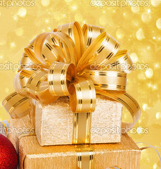 Gift box in gold wrapping paper on a beautiful abstract background (drey) Tags: new year holiday gift christmas box ribbon wrapping event card lacet background gold xmas design decoration greeting celebration white merry season decor traditional paper festive congratulation happy invitation bow present carnival eve yule roll anniversary serpentine streamer scroll surprise garland winter red sphere ball glass adorning silver package yellow star