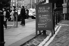 There be monsters (Bilderwense) Tags: edinburgh uk gb greatbritain unitedkingdom scotland street streetphotography oldtown beautifuledinburgh myedinburgh grosbritannien schottland bnw bw sw schwarzweiss schwarzweis blackandwhite monochrome monochrom einfarbig fun alcohol joke