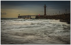 Whitby Pier (Hugh Stanton) Tags: sea sunset pier surf lighthouse beacon