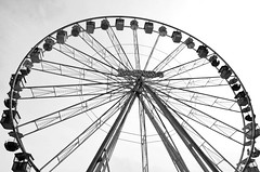 Schtzenfest Hannover: Giant Wheel (slavkit) Tags: park city travel carnival blue sky blackandwhite bw white holiday motion black tourism wheel sign metal architecture modern night germany circle giant fun outdoors happy amusement big high construction iron power view ride spin joy large machine carousel fair ferris hannover tourist equipment entertainment german round huge leisure hanover excitement vector turning attraction