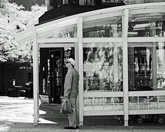 madhatter (local paparazzi (isthmusportrait.com)) Tags: windows shadow summer people blackandwhite bw food white man black detail male glass hat sunglasses contrast standing vintage outside outdoors prime iso100 pod waiting downtown raw sitting dof flavor yum pants state bokeh stroller candid stripes render wheels khaki streetphotography sunny august shades dirty retro 8x10 crop casual local manual madisonwi moment edible groceries statestreet waitingforthebus striped afs pasty madmen autofocus unsuspecting welldressed isthmus dressshoes 2013 nikond90 danecountywisconsin photoshopelements7 pse7 mylesteddywedgers 50mm14g localpaparazzi redskyrocketman lopaps