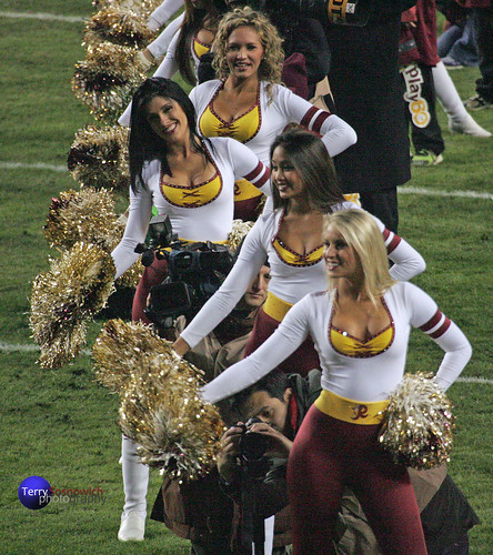 Redskinette Cheerleaders welcome players onto field.