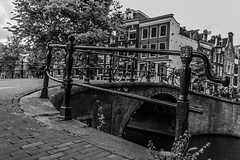(McQuaide Photography) Tags: city bridge blackandwhite bw holland building netherlands monochrome amsterdam architecture canon eos blackwhite europe nederland brug dslr stad gebouw 100d mcquaidephotography