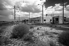 Route 66 - Twin Arrows Trading Post (Frank Footer Fotos) Tags: road trip travel wild vacation arizona sky usa white black southwest west art classic dusty abandoned home station wall sepia clouds america vintage landscape outdoors photography freedom office highway desert post pavement framed telephone fine ruin mother murals twin az roadtrip 66 historic gas adventure route trading posters buy arrows prints americana remote motor poles roadside decor rt cracked tumbleweed attractions
