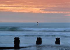 Sunset surfer (Row 17) Tags: uk unitedkingdom gb greatbritain wales ceredigion coast coastal sea seaside seascape groyne sunsets sunset evening surf surfer shoreline shore