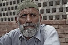 An old man (Usamah Khan) Tags: faisalabad pakistan old man street photography amateur ngc