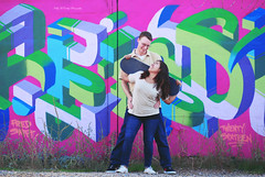 Skater Love (Kelly McCarthy Photography) Tags: couple engagement love colorful catchycolorspurple catchycolorsgreen catchycolorsblue graffiti urban skateboard smile smiles outdoors fun cute woman man