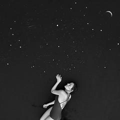 Dust (Miriam Valle) Tags: blackandwhite blancoynegro space cover stars moon girl dark beach blacksand piedras landart arteynaturaleza nature