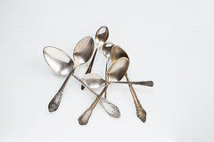Silver spoons on white background (Olga_Z1982) Tags: rough table silverware spoon silver old vintage antique pattern object place kitchen classic background set utensil equipment metal color wood tea wooden white rustic