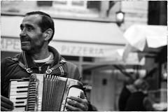 (Roberto Spagnoli) Tags: music musician streetphotography fotografiadistrada streetmusic fisarmonica accordion gipsy people biancoenero blackandwhite 50mmcanon mosso blur
