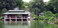 Rest Awhile in the Tea house (jo92photos) Tags: japan garden lake water traditional reflectionstokyo kiyosumigarden 1716 tranquil pinetrees rocks tea house  kiyosumiteien