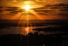 Glowing Sunset over San Diego Marina (Bartfett) Tags: world ocean sunset sea orange sun yellow clouds marina river san bright diego rays seaworld seas