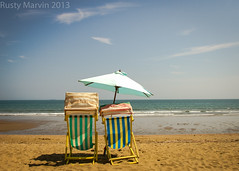 Conversation piece - Don't you know it's Summertime (Rusty Marvin - Imagery by John) Tags: shadow sea england sky cloud beach water yellow umbrella golden sand surf chairs deck parasol isleofwight conversation summertime englishchannel sandown hcs bluecloud itssummer ibjport
